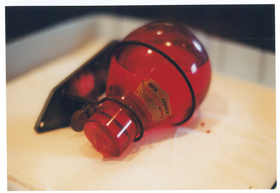 Red Comet fire extinguisher offered to the Morrison County Historical Society for its collections. Because of the chemical inside, MCHS couldn't accept it, but took photos before returning it to the donor. Photo by Mary Warner, 2001.