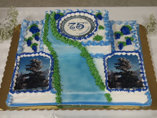 The anniversary cake. We asked for pine trees and the river. The duplicate picture of the pines is actually of the large pine on our museum's property. MCHS 75th anniversary celebration, Royalton American Legion, September 18, 2011.
