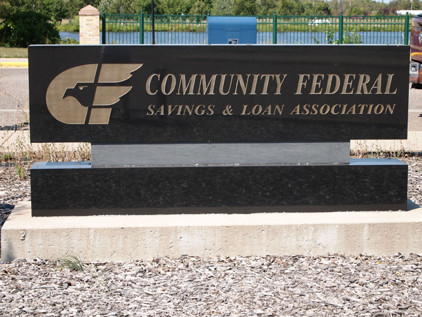 Community Federal Savings & Loan granite sign behind the building. This sign was not removed when the institution changed from Community Federal to Home Savings. Photo by Mary Warner, August 28, 2012.