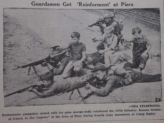 Local boys from Pierz, MN, assisting members of the Kansas National Guard (137th Infantry) during U.S. Army war games hosted by Camp Ripley, August 16, 1940, Little Falls Daily Transcript.