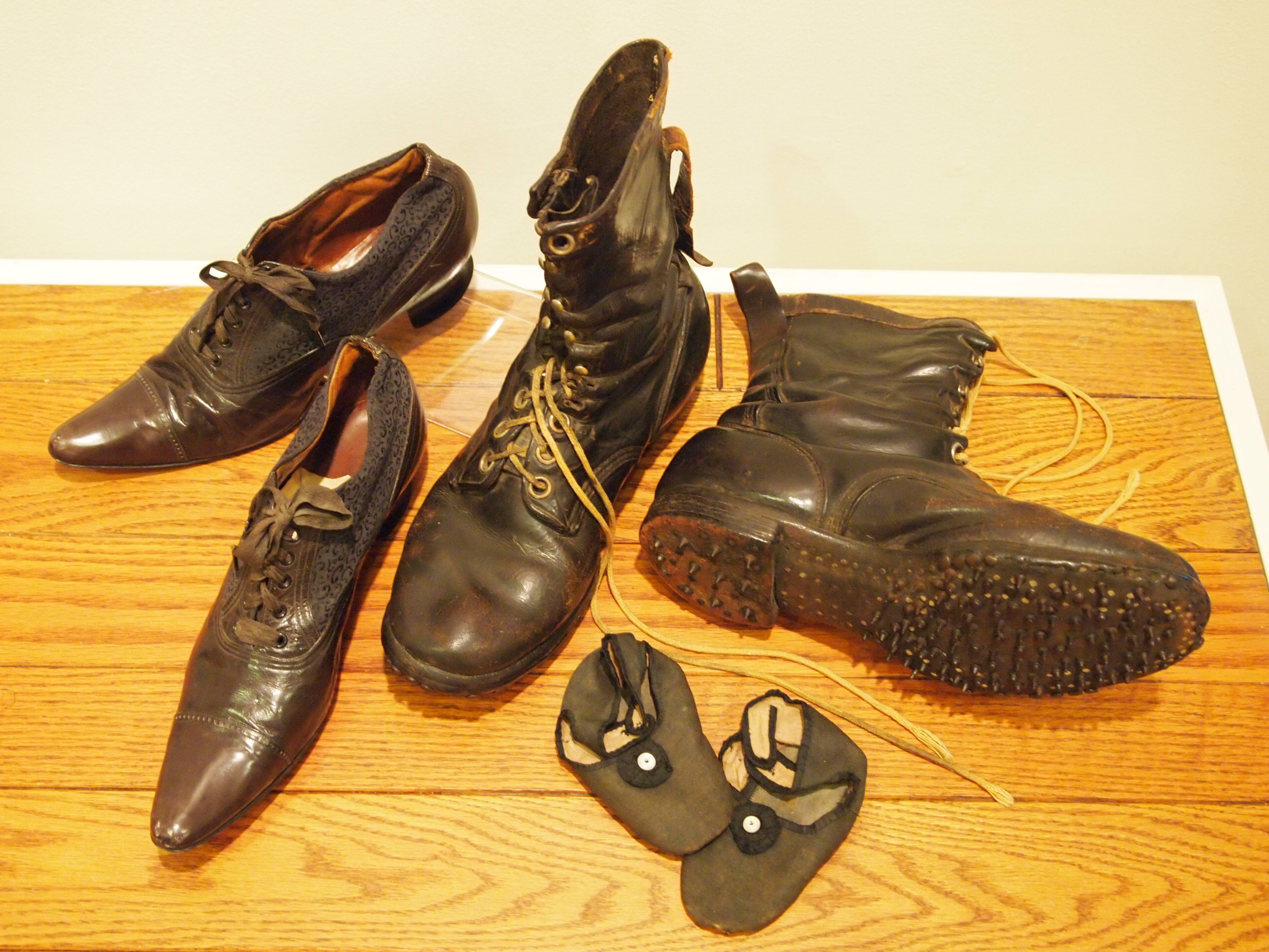 Shoes from the Morrison County Historical Society collection, starting on the left and moving clockwise: Mrs. Lottie Lee Martin's