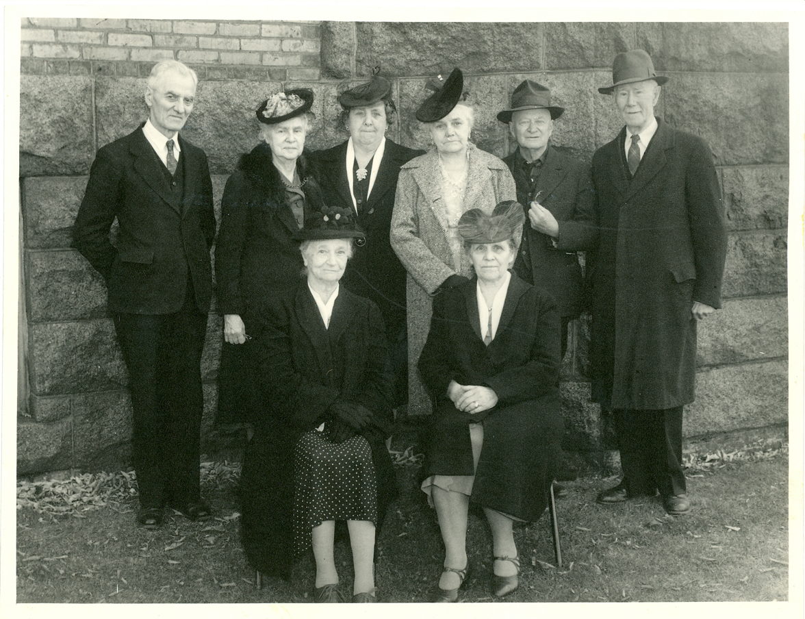 MCHS Founders. From left, standing: Val Kasparek, Mrs. R. L. Cochrane, Mrs. Julius Jetka, Mrs. Warren Gibson, Mr. Warren Gibson, Mr. Harry Stillwell. Seated: Mrs. Harry Stillwell, Mrs. J. K. Martin.