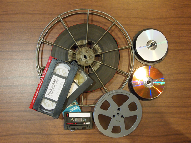 A selection of media from the MCHS collection, including film, videotape, cassettes, CDs and DVDs.