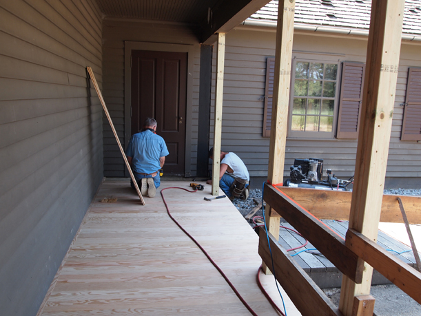 Bob Maschler & his assistant finishing the new floor, July 5, 2012.