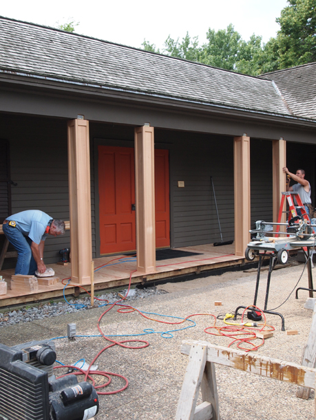Bob and his assistant installing the decorative boxes around the support beams, July 6, 2012.