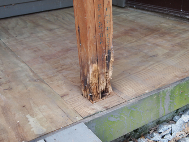 A rotten support beam on the porch, July 3, 2012.