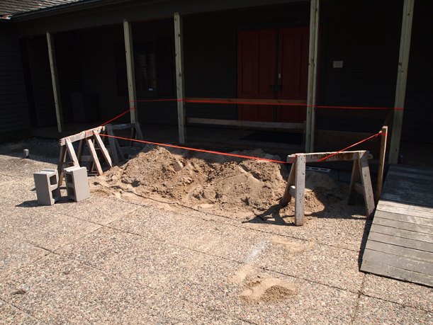 The cement foundation under the old porch was dug out because it had deteriorated from winter salt, July 3, 2012.
