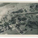 Aerial view showing the flood's effect on Randall, MN (from the northeast), 1972 Flood, Morrison County, Minnesota. Photo by Gene Dubois for the Little Falls Daily Transcript. From the Morrison County Historical Society collections.