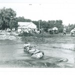 Sandbagging along Highway 10, northeast Little Falls near Cliffwood Motel and Crestliner Boats, 1972 Flood, Morrison County, Minnesota. Photo by Sister Karen Rausch. From the Morrison County Historical Society collections, #1977.57.1.u.