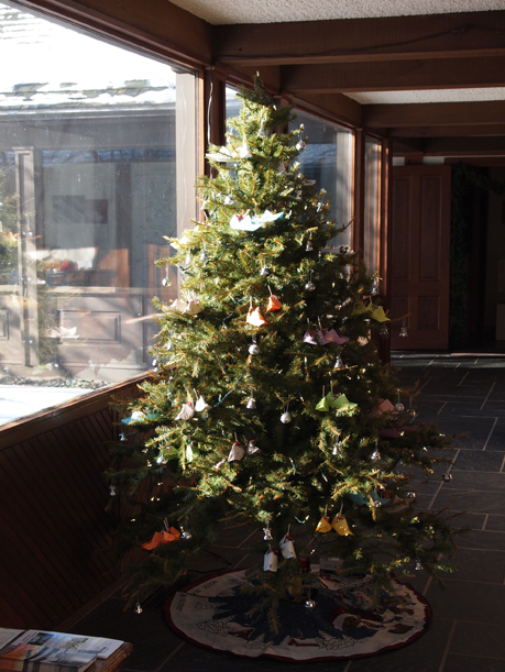 Christmas tree decorated with origami shoes, Morrison County Historical Society, 2014.