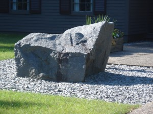 The granite boulder in front of The Charles A. Weyerhaeuser Memorial Museum.