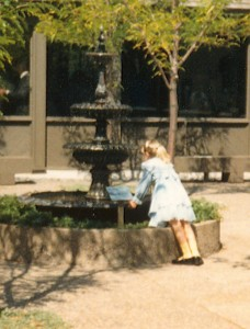 An unidentified girl enjoys the Weyerhaeuser Museum's fountain, which is a memorial to Jane Moyer.