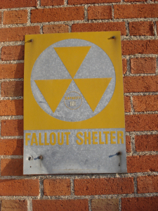 Fallout Shelter sign on Little Falls Post Office, photo taken by Mary Warner, 2014.