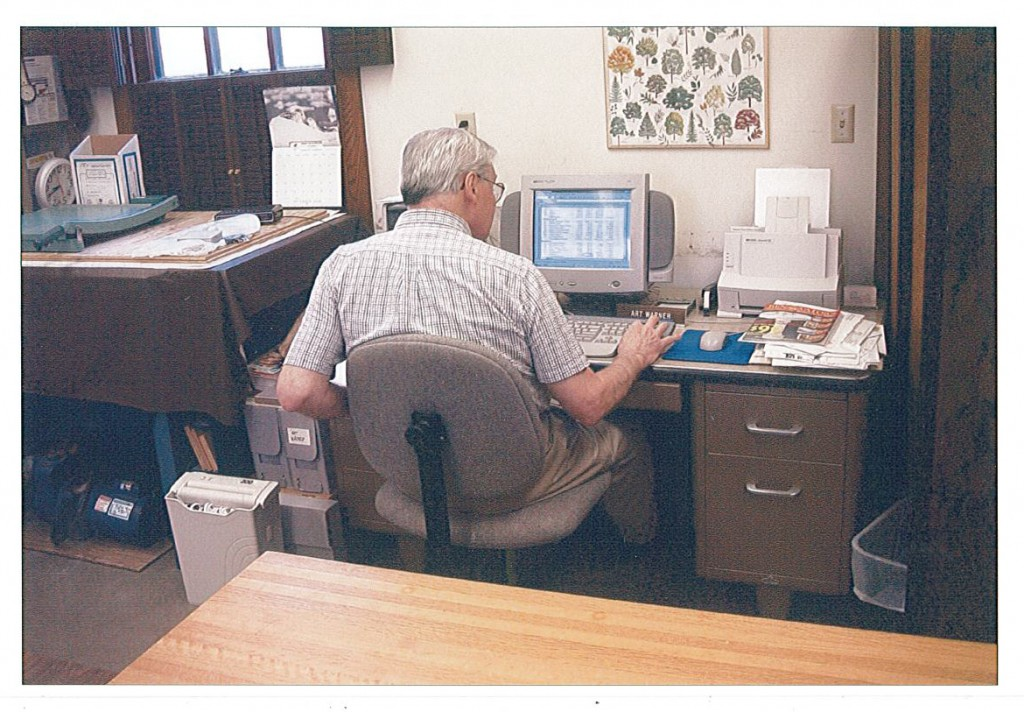 Art Warner, president of MCHS, at work at the Weyerhaeuser Museum. (Note the spreadsheet he has up on the computer.)