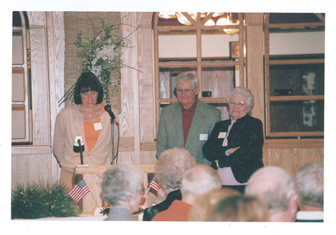 In 2005, the Morrison County Historical Society board presented Art and Jan Warner a commendation for their 40+ years of service to the organization. Board member Deb Collis (left) is presenting Art and Jan with the award during the organization's annual meeting at the Falls Ballroom, Little Falls, MN, October 15, 2005. #2006.16.14.