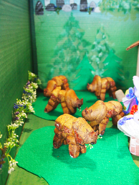 """Close-up of buffalo in """"Peepalo go to Church and Mama said """"Bison.""""""""  The buffalo are cleverly fashioned of two upside-down bunny Peeps for legs and a chick Peep for the head. April 4, 2016."""