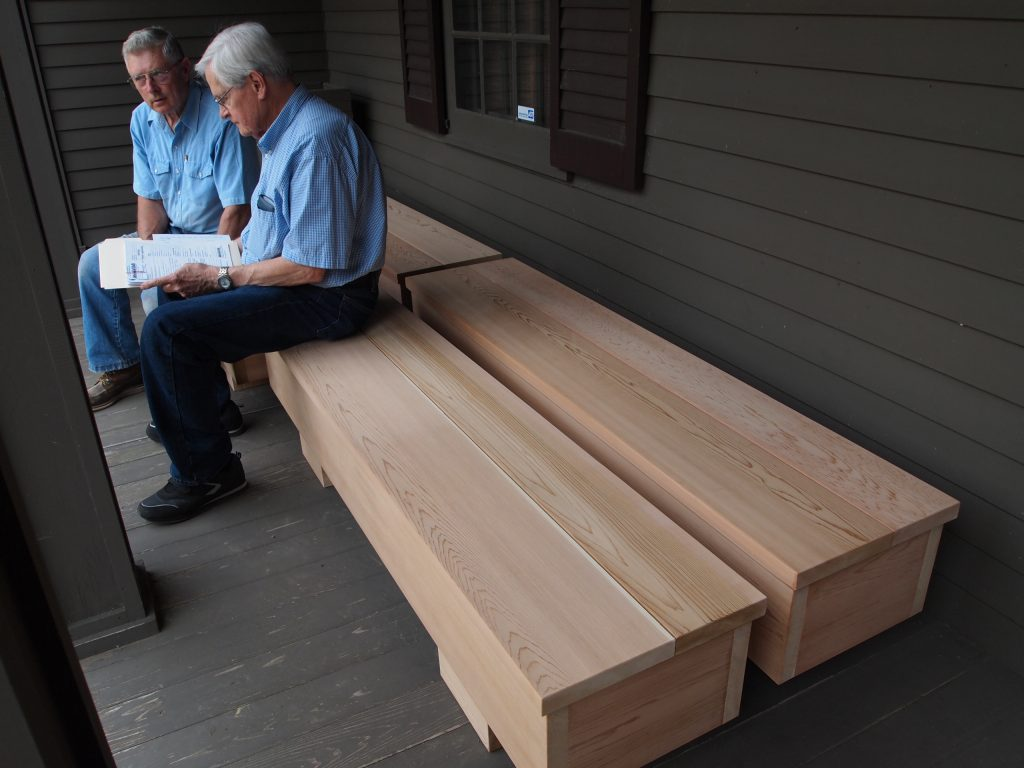 Art Warner reviewing an invoice with Bob Maschler concerning the new museum benches the men are sitting on, June 2012.