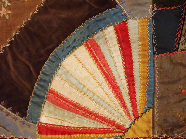 Section of crazy quilt, a fan in red, white & blue. MCHS Collection #1975.40.1.