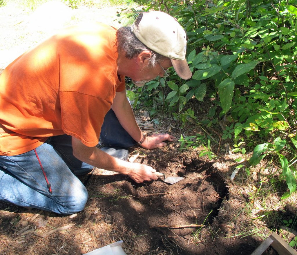 Jim Cummings practicing archaeology. Photo courtesy Mille Lacs Kathio State Park.