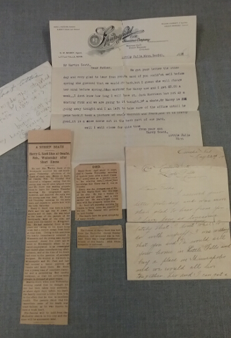 The contents of the envelope containing Harry Scott's story, including 2 letters and 3 newspaper clippings related to his death in 1904.