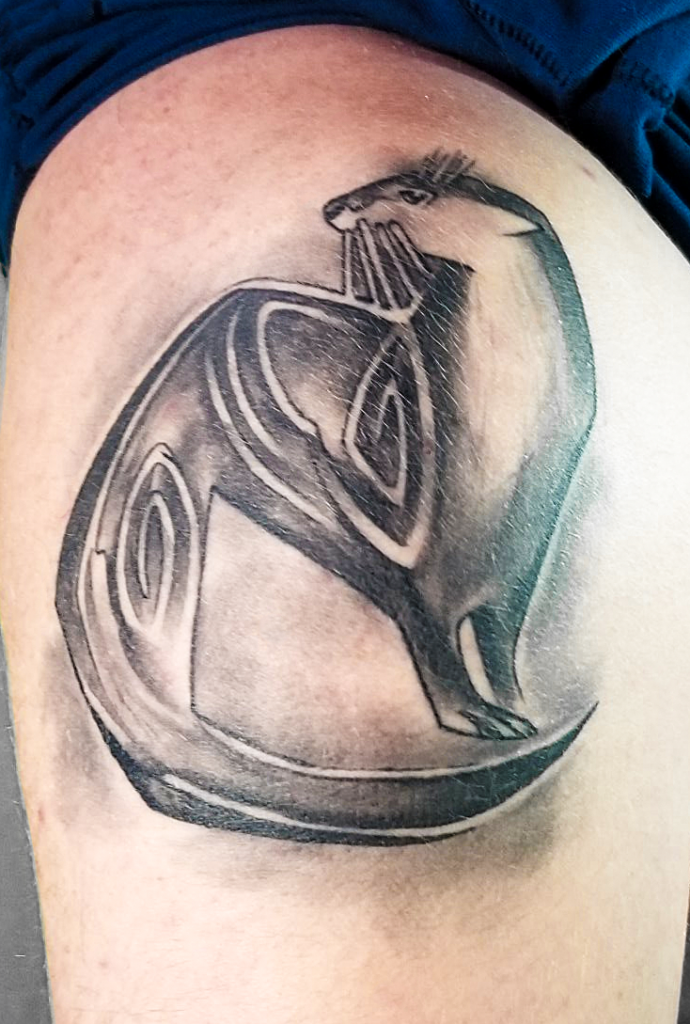 "Tattoo of an otter submitted by Eddie B. This is a visual representation of Eddie's nickname, ""Otter."" From The Story Behind the Tat: Tattoo Art in Central Minnesota, 2019."