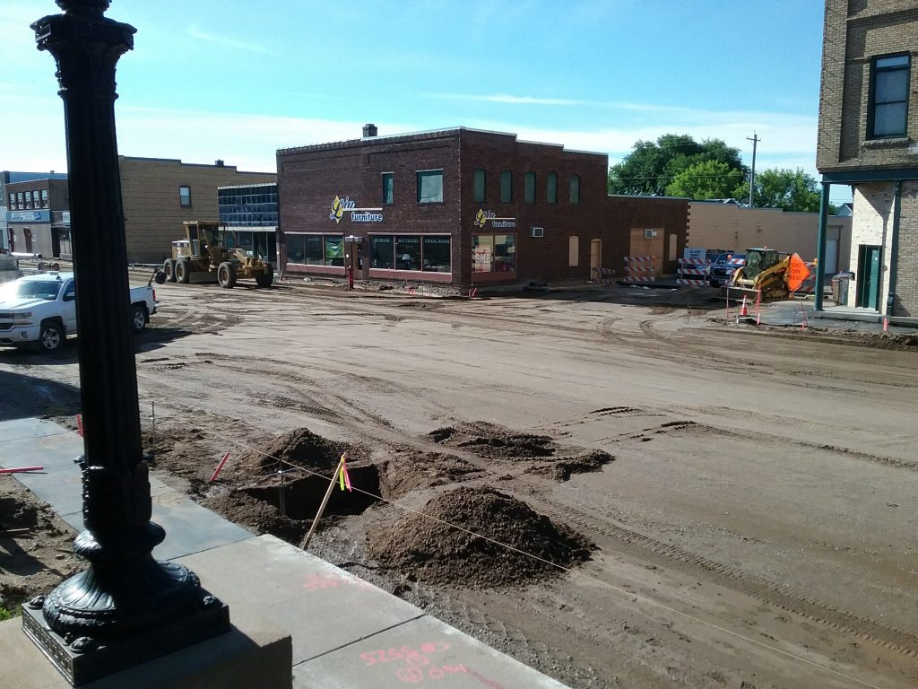 Road construction on Broadway in front of Post Office, Little Falls, MN, July 2, 2019. Progress is being made! The Post Office steps make a great vantage point for seeing a section of the road construction.