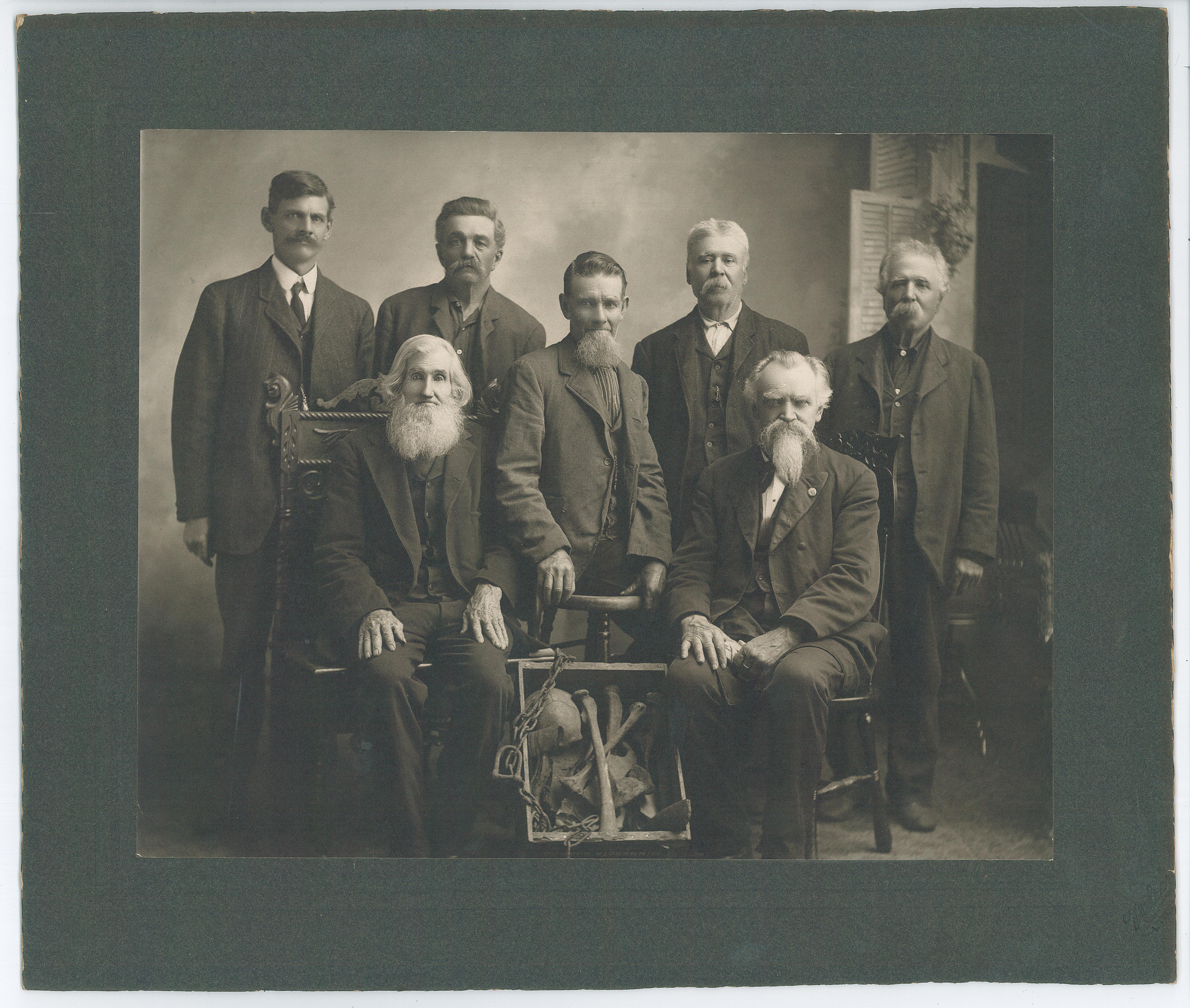Some of the men who dug up the bones of the lynched Native Americans in June 1901. Standing from left: Charles Simmons, Frank Dufort, Sr., James Tanner, Joseph Boisjoli, Leon Boisjoli. Seated: William Nicholson (left), Nathan Richardson (right). Photo c. 1902. #1945.49.1.