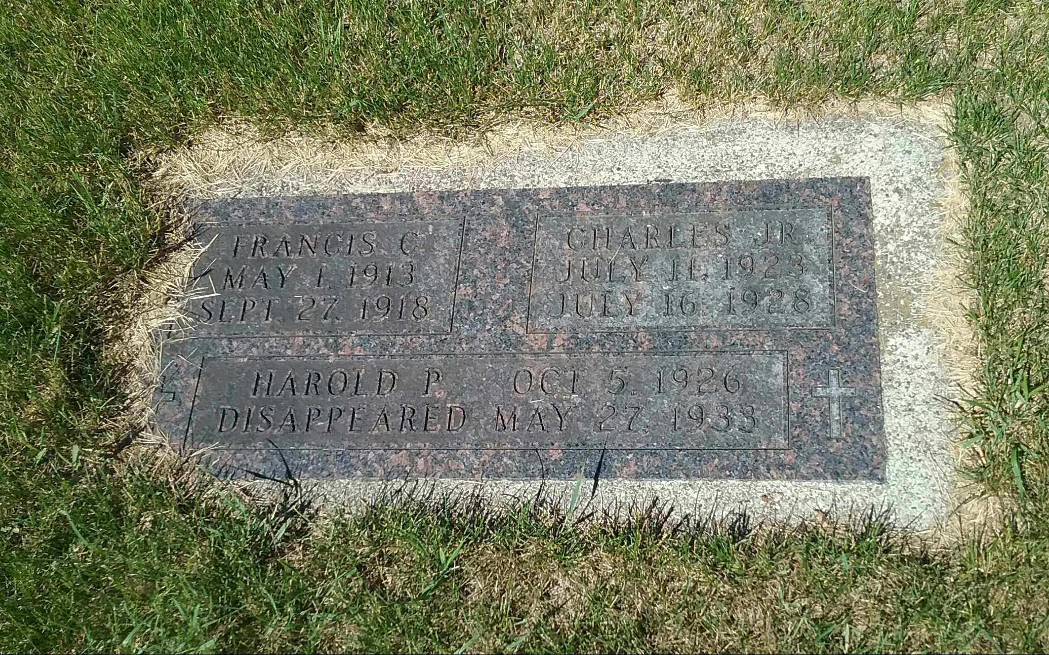 Grave marker for Frances C. and Charles Tidd, Jr., with a memorial to Harold P. Tidd, who disappeared May 27, 1933, located in Calvary Cemetery, Little Falls, MN. Photo by Mary Warner, 2017.