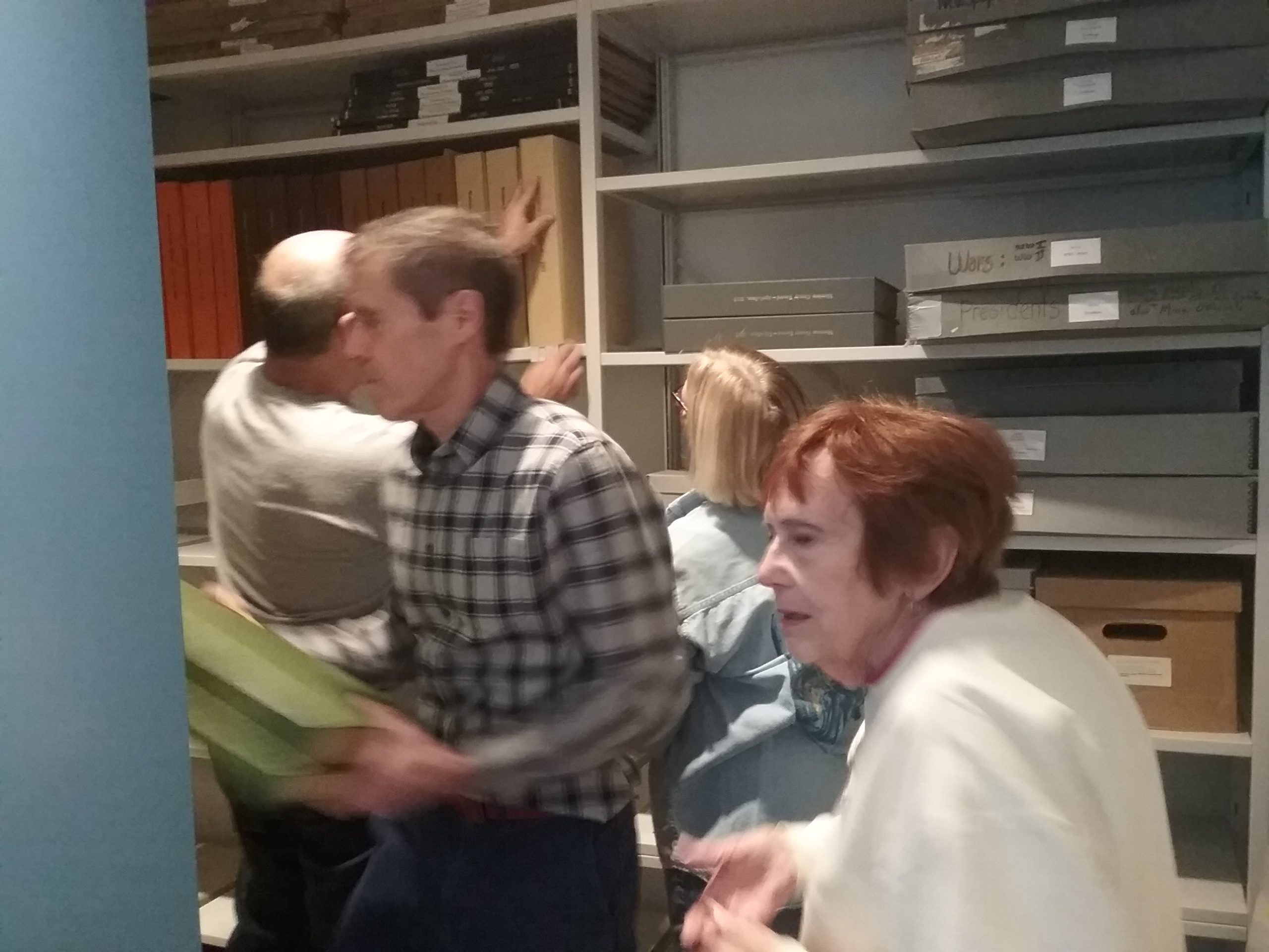 Peter, Cathy, Gary, and Pat putting newspapers on the new mobile shelving in the Archives at the Weyerhaeuser Museum, December 21, 2019.