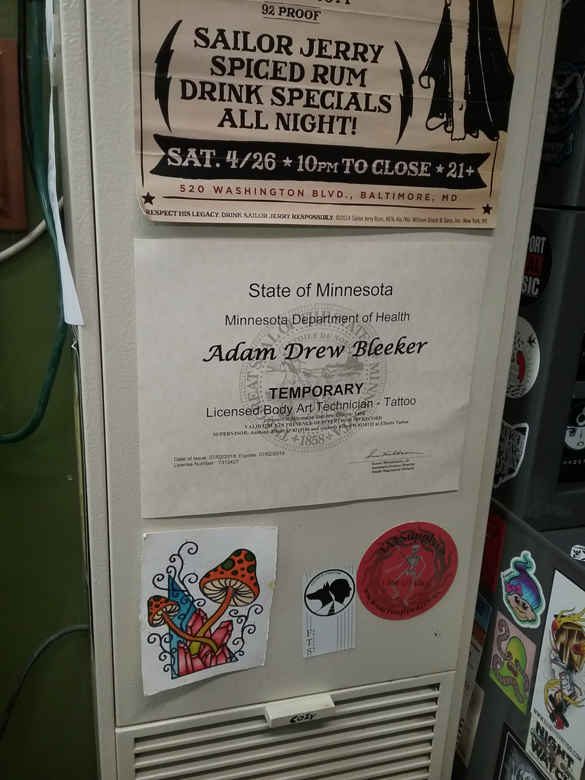 Adam Bleeker's temporary tattoo license that allows him to work as an apprentice at Elliott's Tattoo in Little Falls, MN, February 9, 2019. Photo by Morrison County Historical Society.