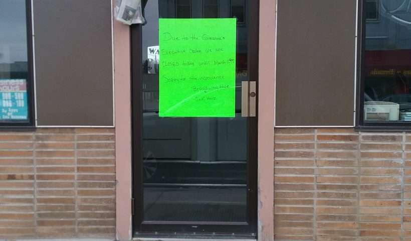 Sign on Little Falls hair salon indicating the business is closed due to Governor Tim Walz's executive order during the COVID-19 pandemic, March 25, 2020.