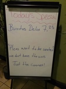 """White board sign at Little Fiesta restaurant in Little Falls, MN. It reads: """"Today's Special: Burritos Delux 7.25 - Pleas sait to be seated - we don't have the virus, Just the Coronas!"""" March 5, 2020"""