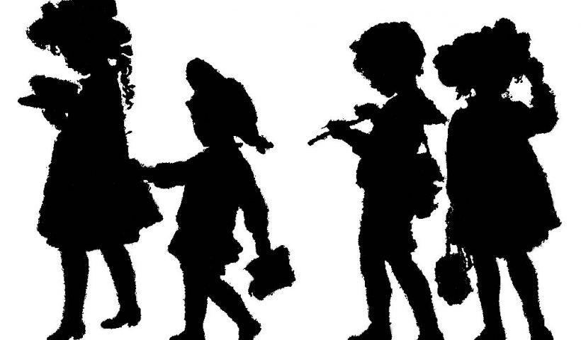 Silhouette of 4 children walking to school