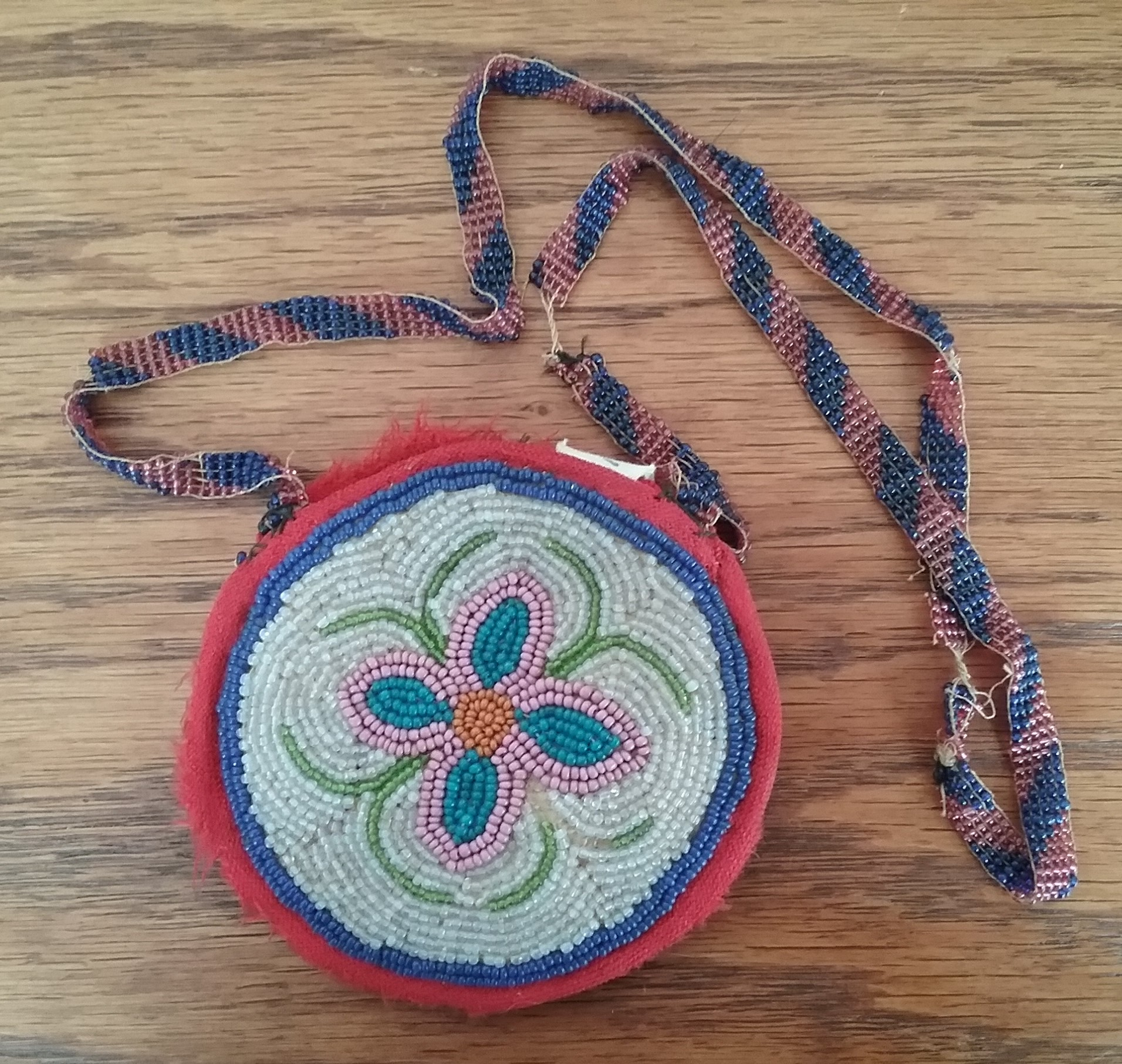 Coin Purse: Round beaded coin purse with beaded strap (first side featuring 4-petaled flower), donated by Viola & Frances Landmeier in 1970. MCHS collections, #1970.22.14.