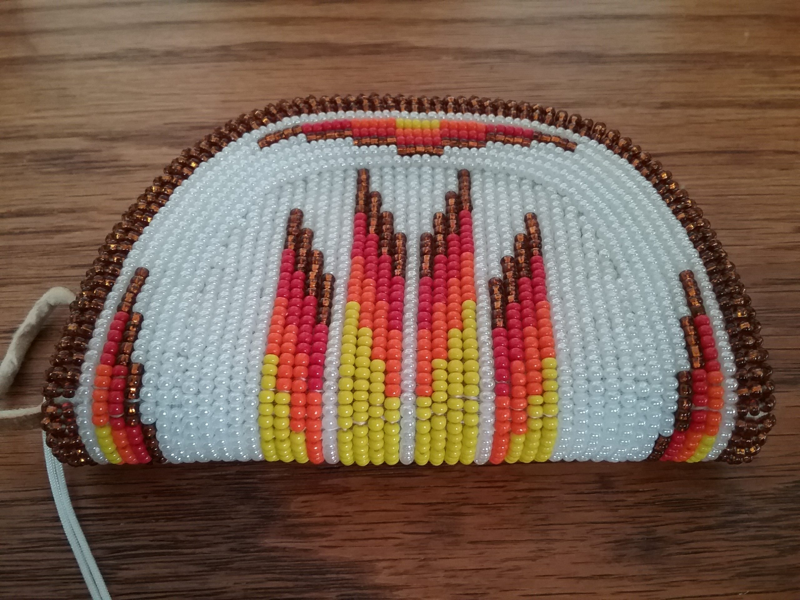 Coin Purse: Purse made by Shishone Bannock in Fort Hall, Indiana, presented by The Church of The Four Winds in Portland, Oregon, to Cindy Moore, who grew up in Morrison County, ­Minnesota. Cindy served as the music director for the church, which is an inter-tribal inter-­denominational Native American church. Purse received in 1996. MCHS collections, #2007.4.1.