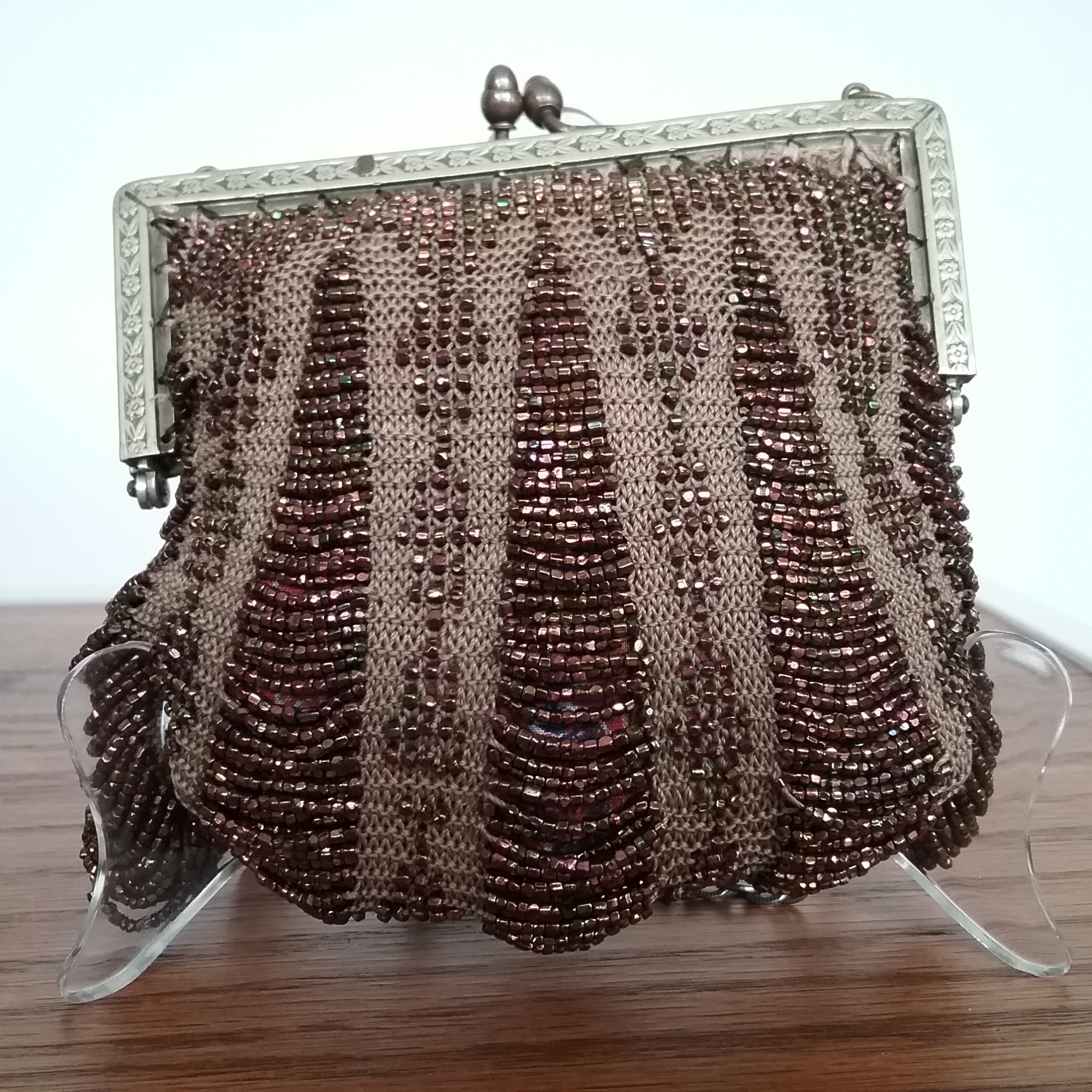 Bronze Purse: Purse featuring bronze seed beads owned by Mrs. Isaac LaBeau. Donated by John & Marge Copa. MCHS collections, #1993.21.1.