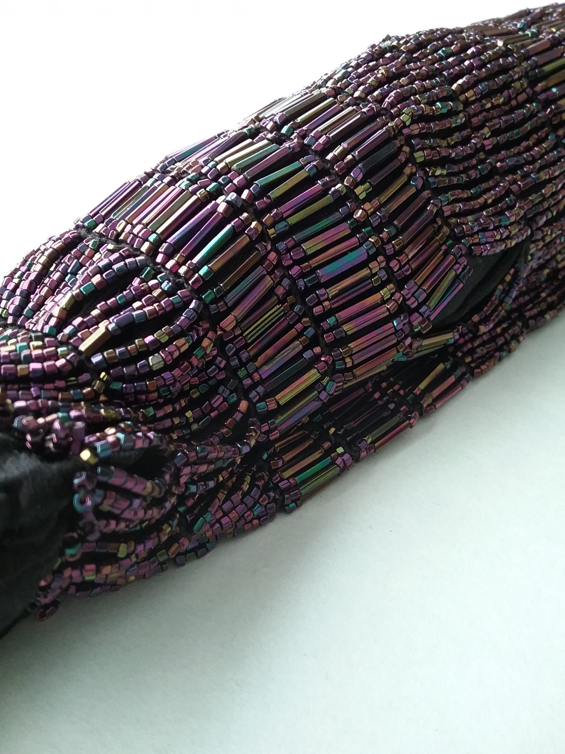 Closeup of evening handbag showing the purple iridescent beads. MCHS collections, #1985.24.18.