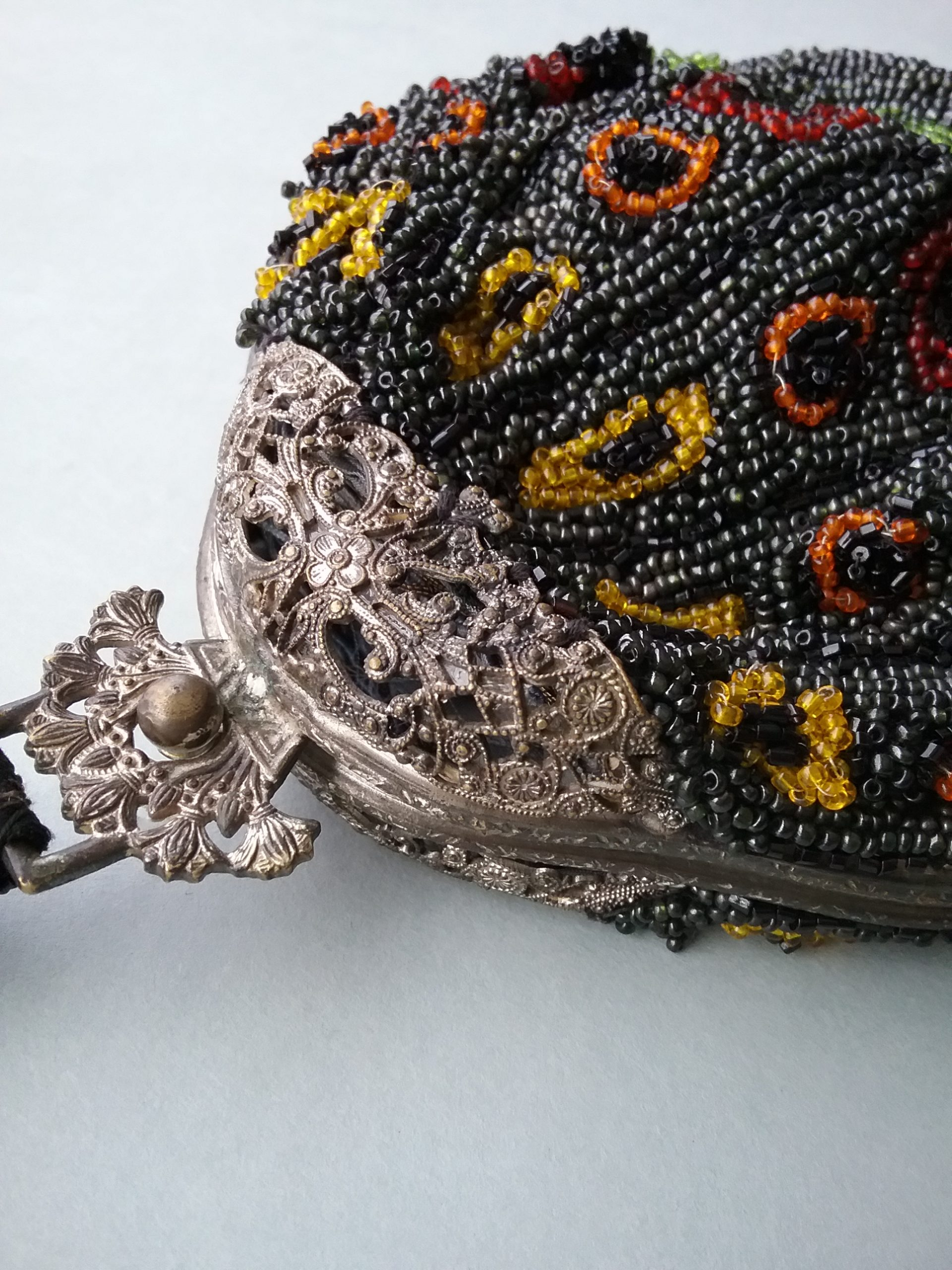 Closeup of evening handbag's metal clasp. MCHS collections, no accession number.