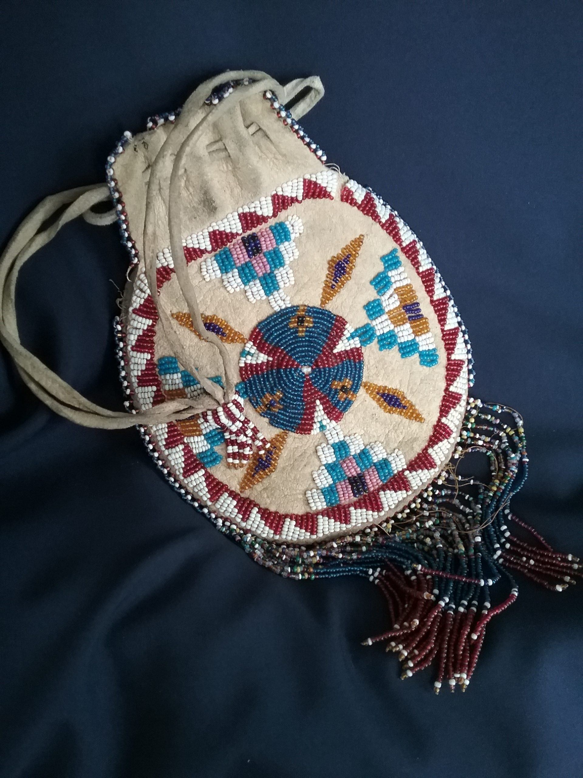 Beaded leather bag (front) from Native American tribe of unknown origin. Donated by Helen Ray. MCHS collections, #1984.14.1.