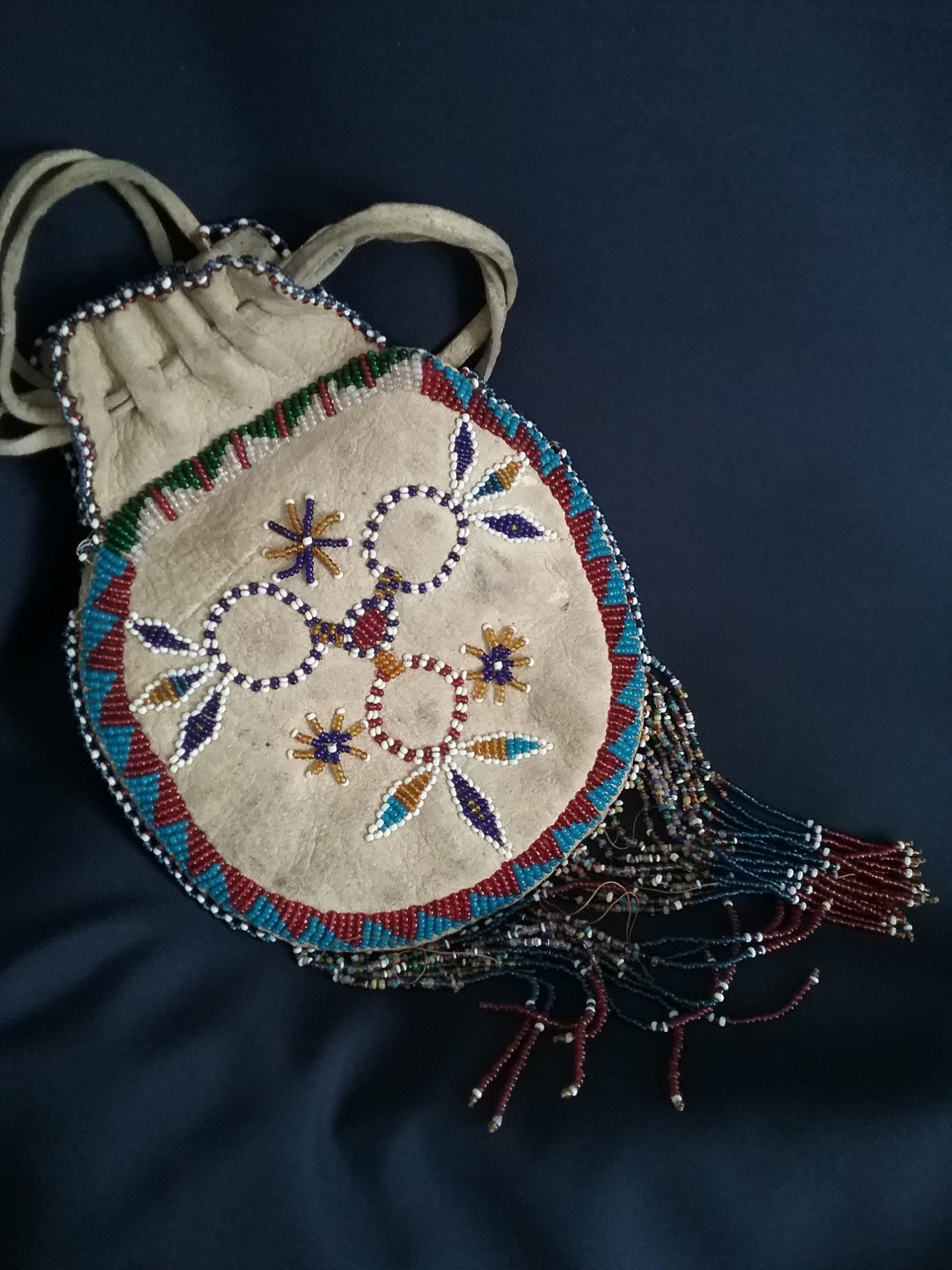 Beaded leather bag (back) from Native American tribe of unknown origin. Donated by Helen Ray. MCHS collections, #1984.14.1.