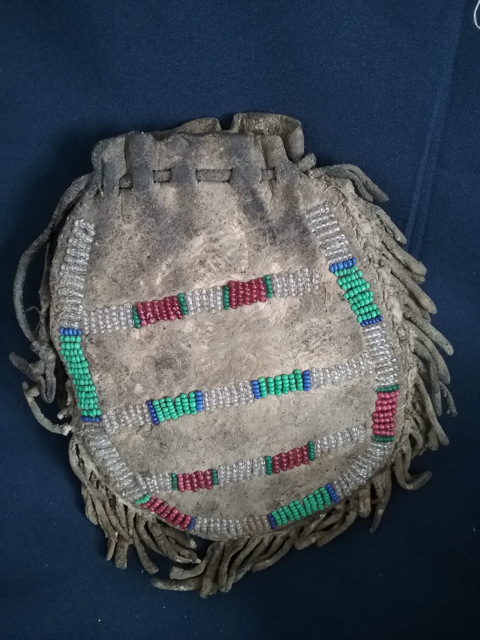 Blackfoot Bag (back): Beaded leather bag attributed to the Blackfoot Nation, c. 1890. This bag was brought to Minnesota by Earl E. Bundy, who worked with a group of Blackfoot Indians on a cattle ranch. He was 17 when he got this bag. Donated by Carol Holmquist. MCHS collections, #1990.28.1.