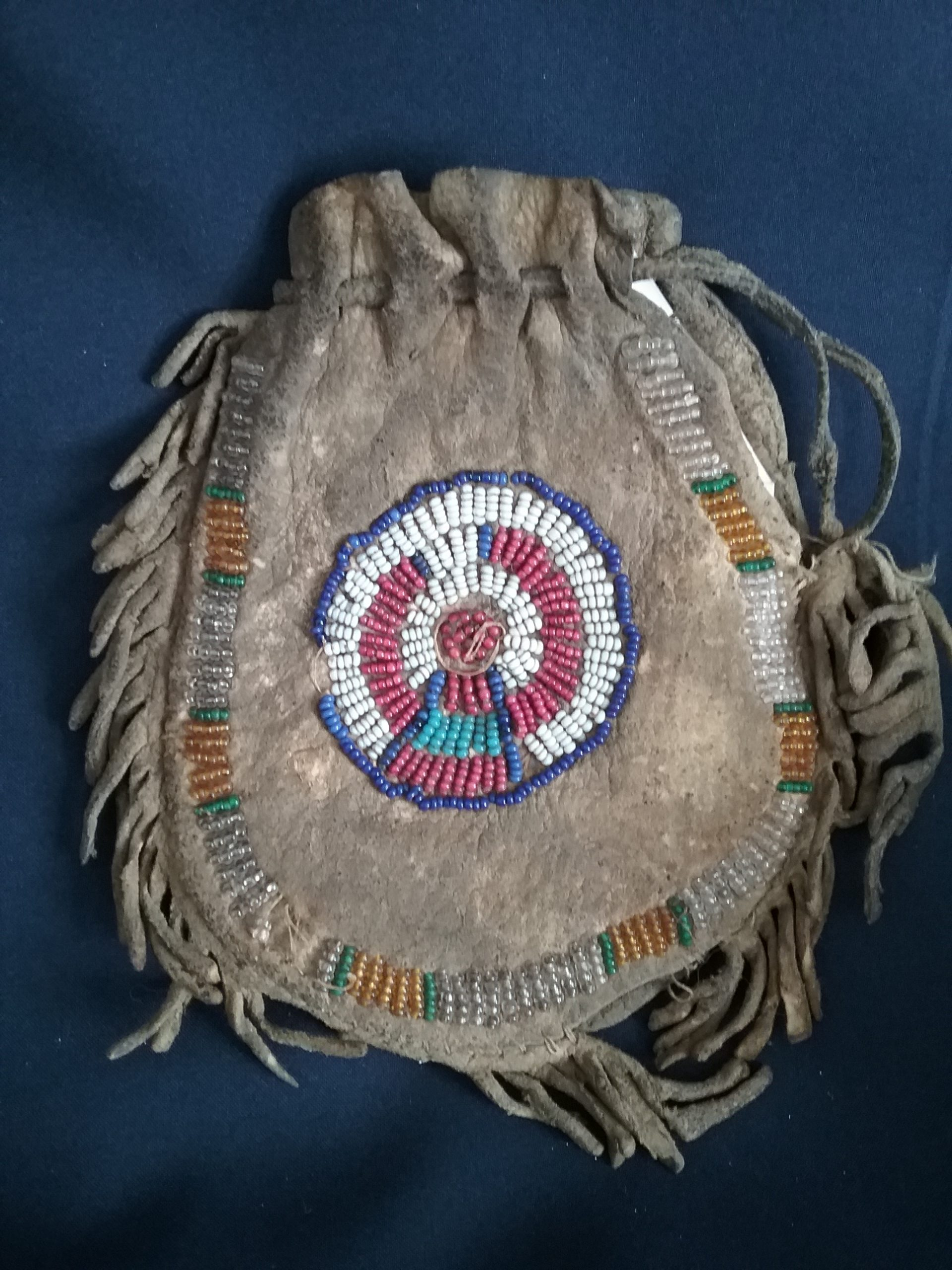 Blackfoot Bag (front): Beaded leather bag attributed to the Blackfoot Nation, c. 1890. This bag was brought to Minnesota by Earl E. Bundy, who worked with a group of Blackfoot Indians on a cattle ranch. He was 17 when he got this bag. Donated by Carol Holmquist. MCHS collections, #1990.28.1.