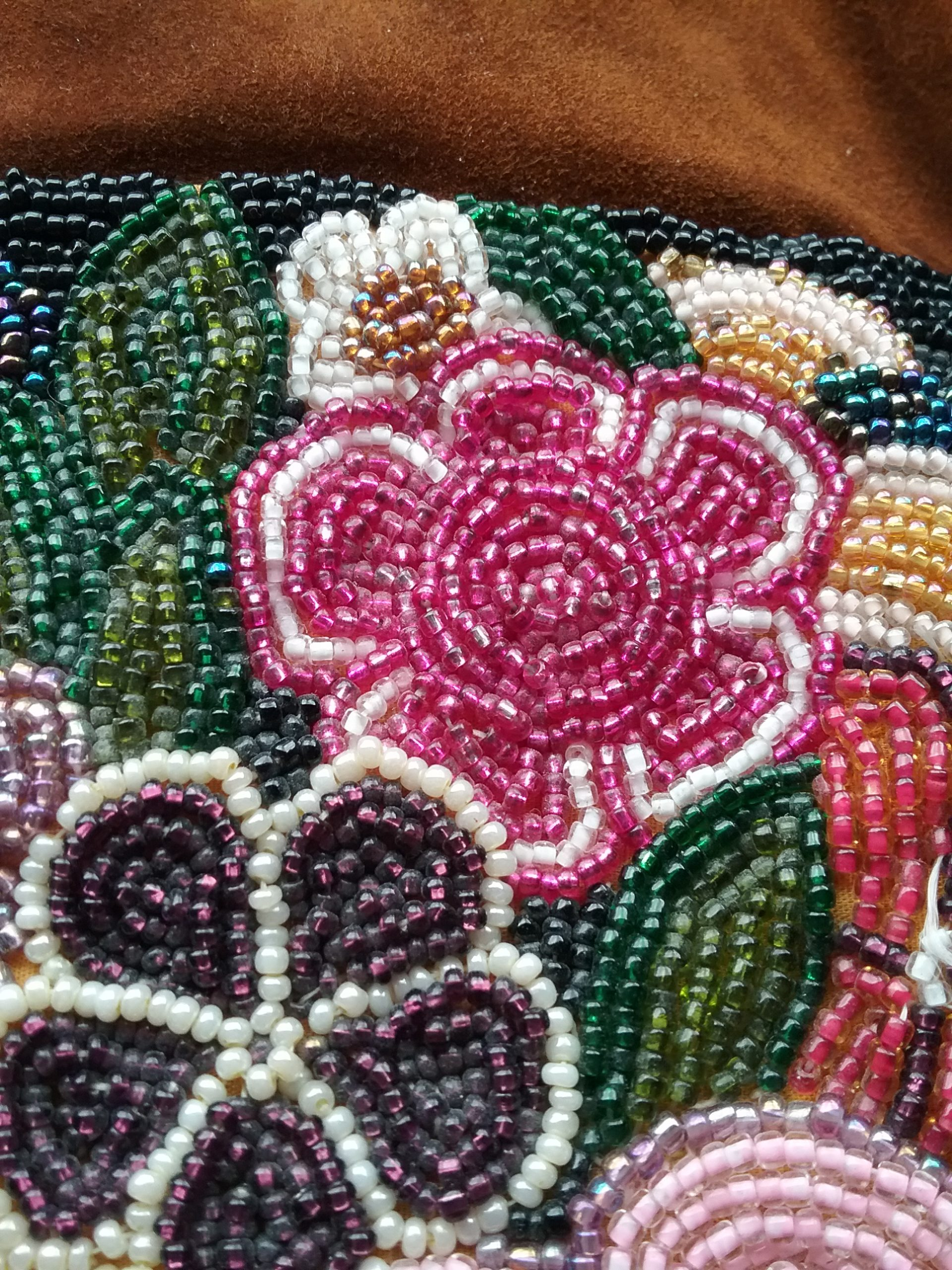 Detail of beadwork on beaded leather bag made by Sister Carol Schmit, OSF. On loan for the BEAD Exhibit from Sr. Carol Schmit.