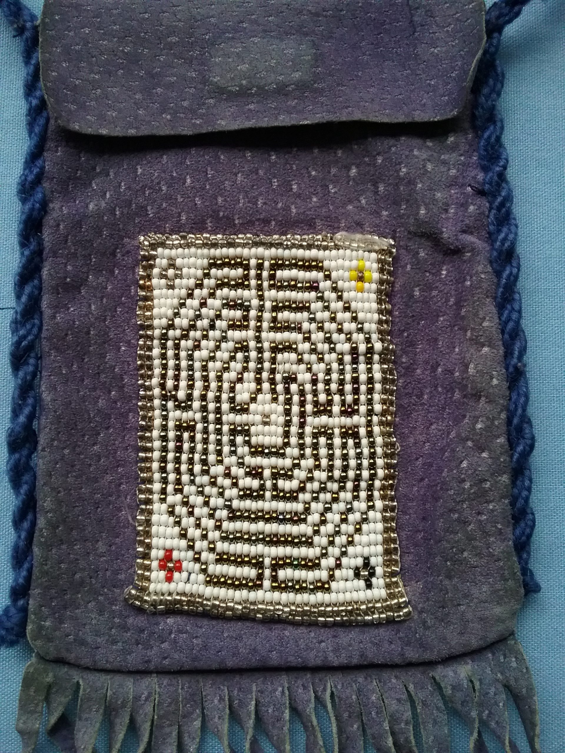Closeup of the Baby Chartres design in Sister Carol Schmit's small beaded bag. Note the four colored crosses in the corners. On loan from Sister Carol Schmit, OSF.