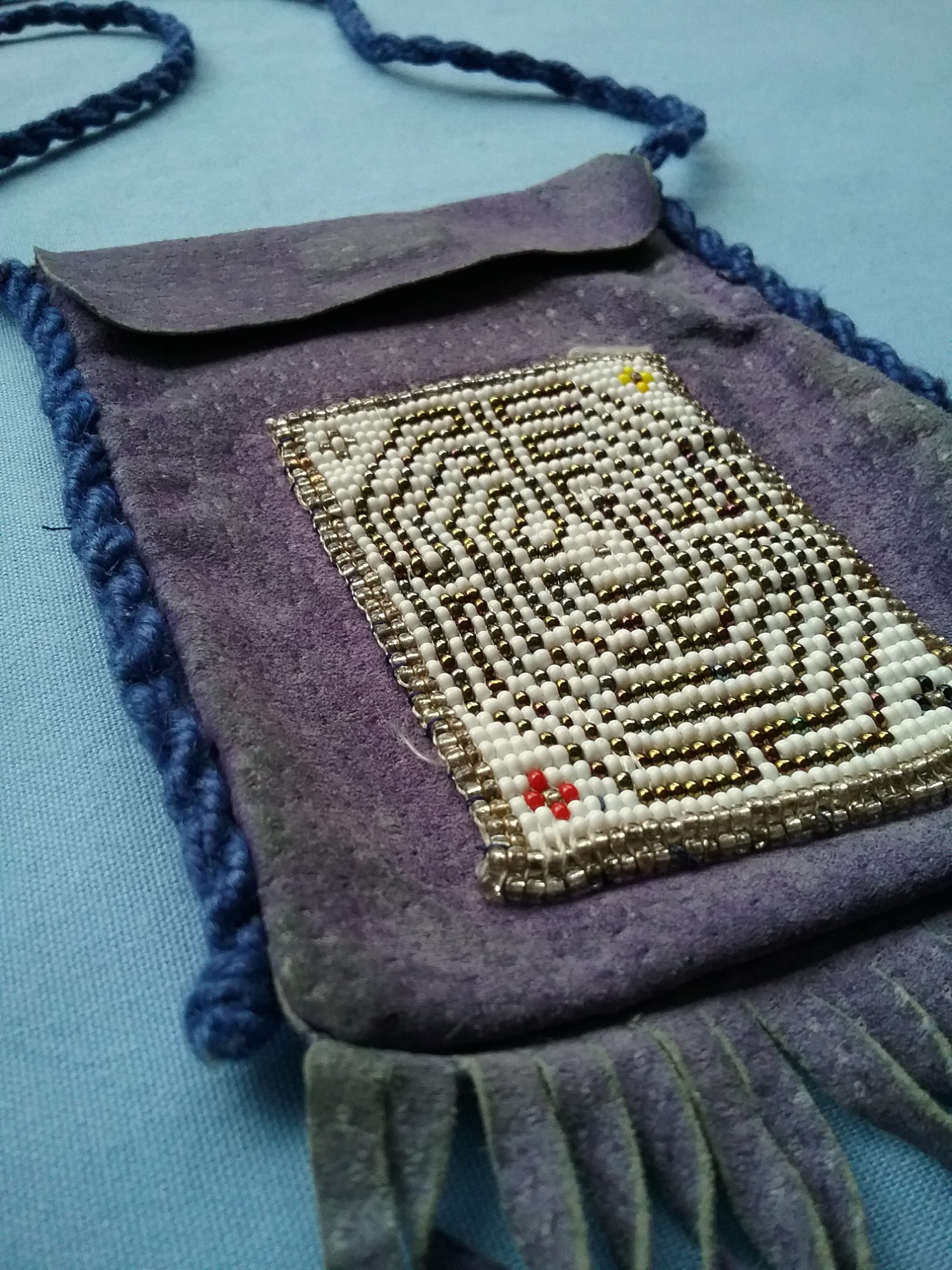 Detail of the Baby Chartres bag made by Sister Carol Schmit. On loan from Sister Carol Schmit, OSF.