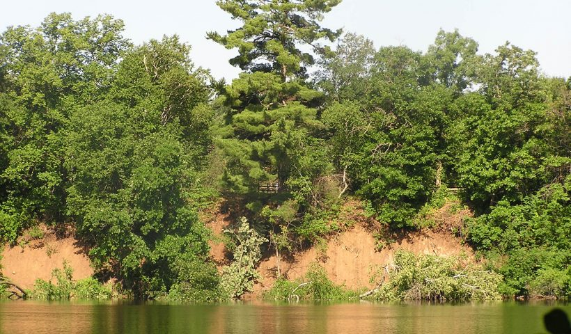 This shows the washout under the Big Pine from across the river. Photo by Ren Holland, July 3, 2020.