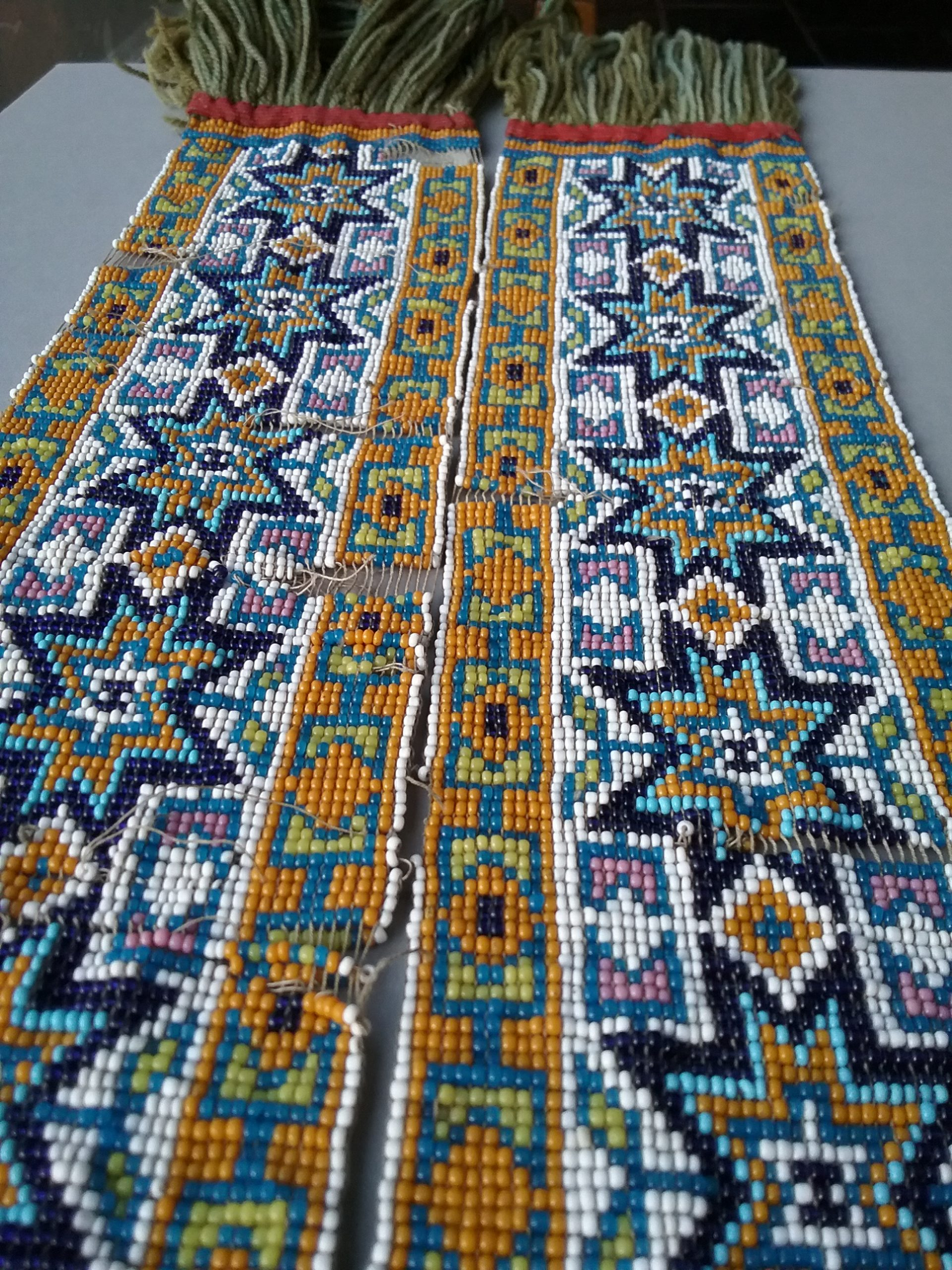 Beaded Leg Bands: These loom-woven beaded leg bands were presented by the Mille Lacs Band of Ojibwe to Nathan Richardson. Donated by Mary (Richardson) Harker. MCHS collections, # 1940.42.12a&b.