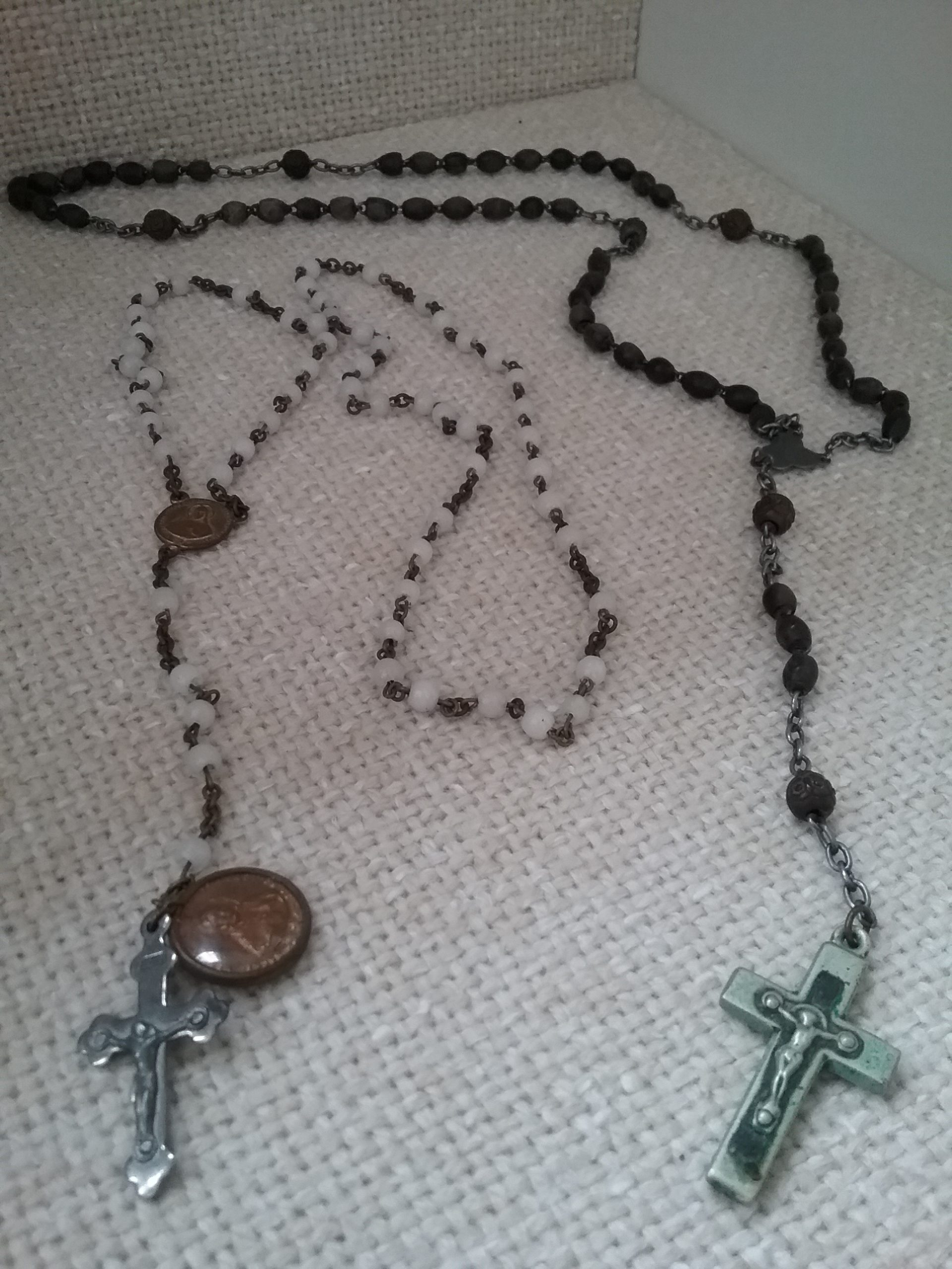 Catholic Rosaries, one with white beads, the other with black beads. Donated by Stella LeBlanc. MCHS collections.