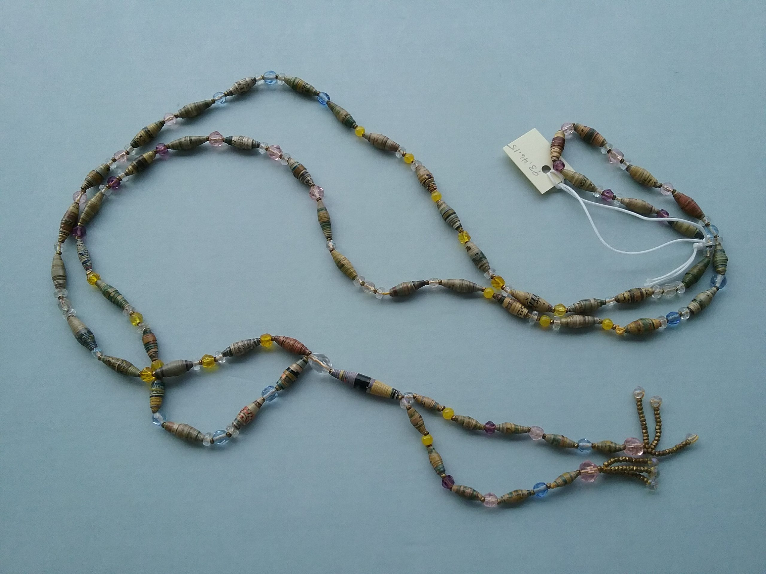 Necklace of Rolled Beads: The beads in this necklace have been made of strips of a material (likely paper) that have been rolled to form the beads. Donated by Lucy Tanner. MCHS collections, #1993.46.15.