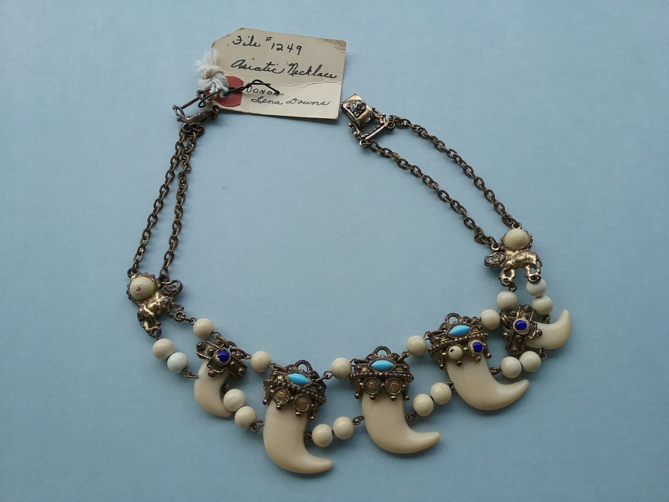"Asiatic Necklace: This necklace featuring claws and beads is labeled as ""Asiatic,"" though the actual origin is unknown. Donated by Lena Downs. MCHS collections, #1960.3.1."